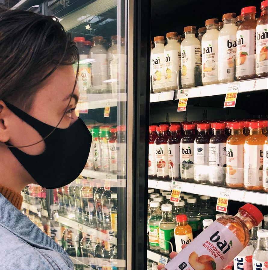 Senior Emma J Nelson reps a light weight cloth mask on a trip to the grocery store. Her family began stocking up on both store bought and handmade facial coverings as soon as COVID-19 presented itself in Oregon. Photo by Gillian Nelson.