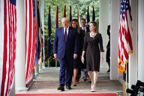 Amy Coney Barrett walks the White House grounds with her nominator, President Donald J. Trump. Barrett was confirmed to fill Ruth Bader Ginsburg