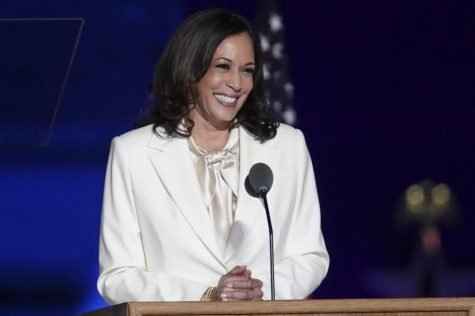 Vice president-elect Kamala Harris smiles at the crowd gathered to celebrate Joseph R. Biden's projected victory. Harris made history as the first woman, African-American and Asian to become Vice President on Jan. 20. Photo courtesy of  Sarah Silbiger/Bloomberg/Getty Images.